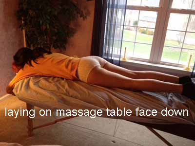 laying on massage table face down